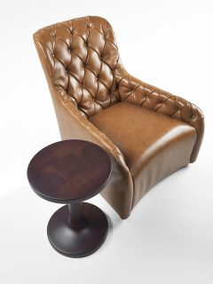 ribot poltrona elegante capitonnè forte carattere linee tondeggiante tessuto pelle armchair high class trendy fashionable rounded shape leather fabric